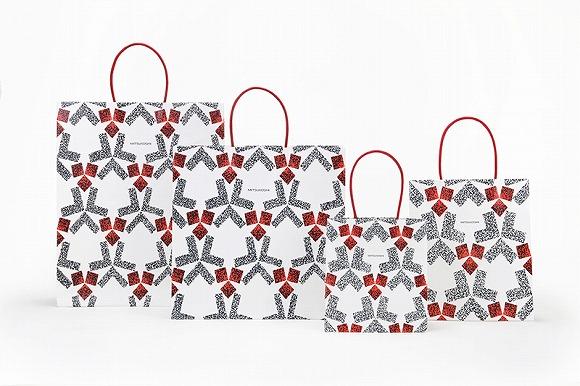 三越の新しいショッピングバッグがなんだかとってもジャパネスク! たわわに実るリンゴを幾何学模様で表現しているらしい