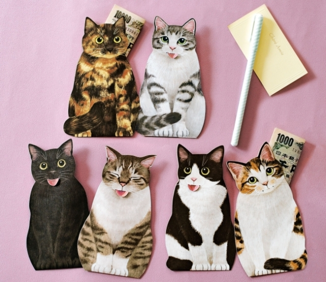 """猫の """"舌のしまい忘れ"""" を再現した「ぽち袋」の可愛さにグッとくる! 舌が留め具の役割になっています♪"""