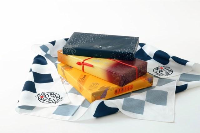 有名土産「白い恋人 × 萩の月 × 博多通りもん」がセットになったBOXが発売に! オリジナル風呂敷もついてくるよ